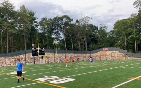 The first day of football practice saw players close in spirit but far in distance.